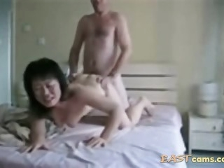 Chinese milf getting her..