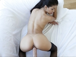 Busty Latina babe bends over..