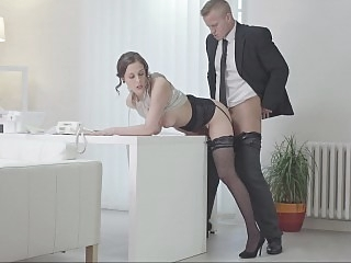 Secretary bent over the desk..