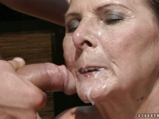 Raunchy granny gets her face..